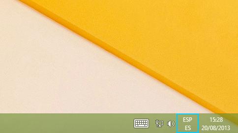 Botón de abreviatura de idioma en la barra de escritorio